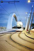 Lyon City And Tramway On The Confluences Bridge