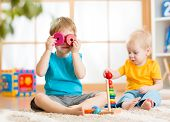 pic of indoor games  - children boys playing with educational toys indoors - JPG