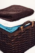 Laundry. Wicker basket with clean towels