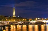 stock photo of stroll  - While taking a romantic night stroll on Pont Alexandre III - JPG