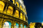 The Colosseum at night in Rome, Italy.