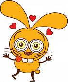 Cute yellow bunny feeling madly in love