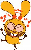 Cute yellow bunny listening to music and dancing