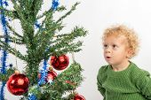 Little Boy Looking At The Christmas Tree With Envy
