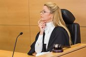 stock photo of court room  - Stern judge looking and listening in the court room - JPG