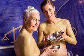 Woman at Rasul bath in wellness spa