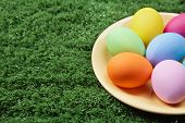 Close-up of coloured Easter eggs on plate