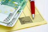 Blank invoice with pen and money (euros)