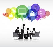 Group of business people discussing in a white background with colorful speech bubbles above containing social networking symbols.