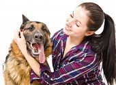 Portrait of a smiling young woman  and German shepherd