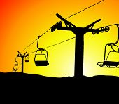 Ski lift chairs at sunset