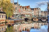 picture of old bridge  - Old buildings canal and bridge in Lier Flanders Belgium - JPG