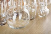Different glassware on wooden table background