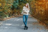 Pretty Girl In A Pullover Standing In Autumn Park