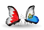 Two Butterflies With Flags On Wings As Symbol Of Relations Bahrain And San Marino