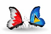 Two Butterflies With Flags On Wings As Symbol Of Relations Bahrain And Saint Lucia
