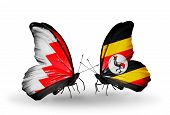 Two Butterflies With Flags On Wings As Symbol Of Relations Bahrain And Uganda