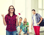 education concept - smiling female student in eyeglasses with diploma