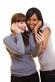 Two Women Listening To Cell Phone Music