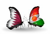 Two Butterflies With Flags On Wings As Symbol Of Relations Qatar And Niger