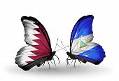 Two Butterflies With Flags On Wings As Symbol Of Relations Qatar And Nicaragua