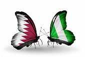 Two Butterflies With Flags On Wings As Symbol Of Relations Qatar And Nigeria