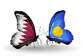 Two Butterflies With Flags On Wings As Symbol Of Relations Qatar And Palau