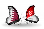 Two Butterflies With Flags On Wings As Symbol Of Relations Qatar And Singapore