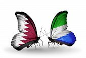 Two Butterflies With Flags On Wings As Symbol Of Relations Qatar And Sierra Leone