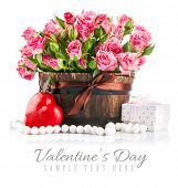 Bunch pink roses with gift to day saint valentine. Isolated on white background