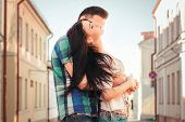Young Couple Kissing In The Town. Love Kiss