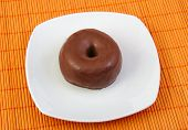 Chocolate doughnut. Donut in a white dish