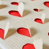 holes on a kraft paper forming hearts