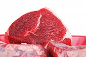 fresh meat : raw uncooked fat lamb pork fillet mignon loin on red tray isolated over white background