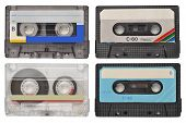 stock photo of magnetic tape  - Four retro cassette tapes isolated on white - JPG