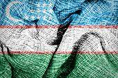 Uzbekistan flag on fabric surface