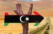 foto of libya  - Libya Flag wooden sign with desert road background - JPG