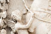 stock photo of cherub  - detail of a cherub marble in Rome - JPG