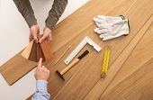 pic of baseboard  - Carpenter showing some wooden baseboard swatches to a customer and choosing a color flooring installation and work tools on background - JPG