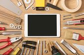 picture of workbench  - Digital touch screen banner with DIY and work tools all around on a wooden table top view - JPG
