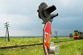 picture of railroad-sign  - Traffic lights and signs at the railroad crossing and the approaching train  - JPG