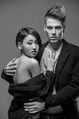 pic of tuxedo  - Young fashionable couple in tuxedos posing in the studio - JPG