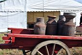 vintage milk churns on an old cart