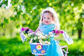 picture of little young child children girl toddler  - Happy child riding a bike - JPG