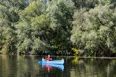 picture of canoe boat man  - View of the young man rowing in a canoe - JPG