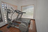foto of health center  - Exercise machines in luxury private health center gym room - JPG