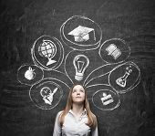 picture of degree  - Young beautiful business lady is thinking about getting degree at the university - JPG