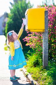 image of mailbox  - Little girl with an envelope at post office - JPG