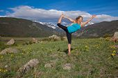 Yoga pose in the meadow