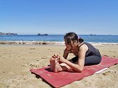 Bikram Yoga Paschimottanasana Pose At Beach